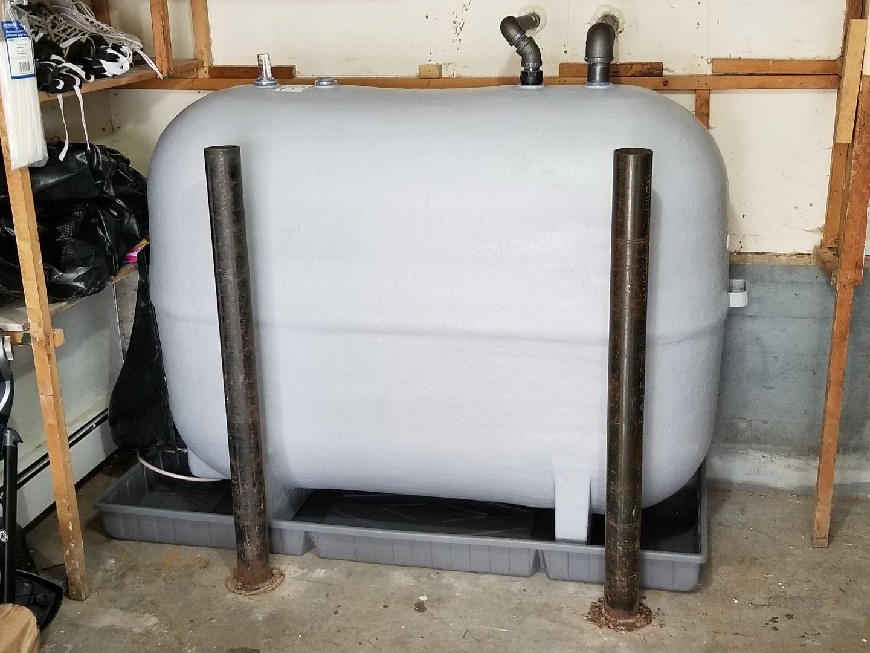 Fuel tank installation in a garage.